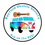 Volkswage Bus with a ukulele on top